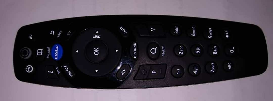 How do you access the settings option on your DSTV decoder remote control?